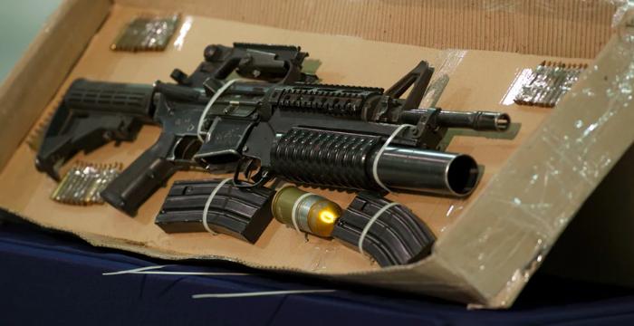 Politie-invallen voor wapenhandel