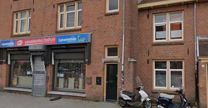 Woning boven avondwinkel beschoten in Amsterdam-Noord